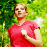 Woman In Red Running Stock Image