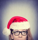 Woman with red Santa Claus hat looking up Stock Photography