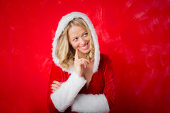 Woman in red Santa costume being thoughtful royalty free stock photos
