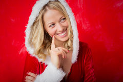Woman in red Santa costume thinking royalty free stock images