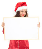 Woman in red Santa hat with blank poster Royalty Free Stock Photos