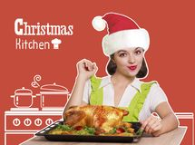 Woman with red Santa hat cooking roast christmas chicken .Kitchen background. With text stock photography