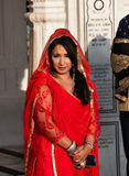 Woman in a red saree in Golden Temple. Amritsar. India Stock Image