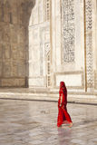 Woman in red saree at Taj Mahal. royalty free stock photography