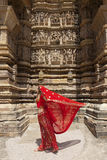 Woman in red sari, Khajuraho. Stock Photos