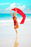 Woman with red sarong Royalty Free Stock Image