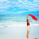 Woman with red sarong Royalty Free Stock Images