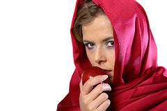 Woman in red scarf with apple. Blond woman in red scarf eating an apple royalty free stock images