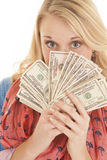 Woman red scarf look over money Stock Photo
