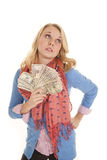 Woman red scarf look up money Royalty Free Stock Photo