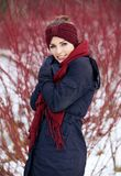 Woman with Red Scarf in a Winter Park Royalty Free Stock Photography