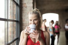 Woman in Red Scoop-neck Tank Top Holding White Mug Stock Images