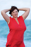 Woman in red at the sea Stock Photo
