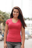 Woman in a red shirt Stock Photography