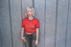 Woman in Red Shirt and Black Pants Royalty Free Stock Photography