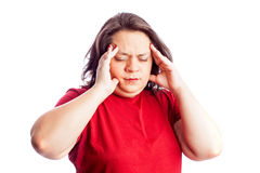 Woman in red shirt with hand on head Royalty Free Stock Images