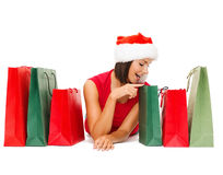 Woman in red shirt with shopping bags Stock Photography