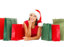 Woman in red shirt with shopping bags Stock Photos
