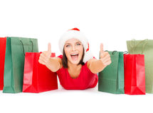 Woman in red shirt with shopping bags Royalty Free Stock Photography