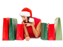 Woman in red shirt with shopping bags Stock Image
