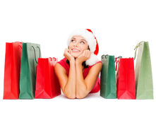 Woman in red shirt with shopping bags Stock Photo