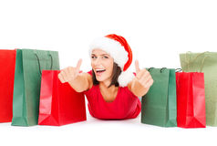 Woman in red shirt with shopping bags Royalty Free Stock Photos