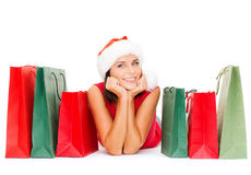 Woman in red shirt with shopping bags Royalty Free Stock Image