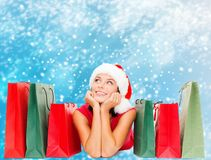 Woman in red shirt with shopping bags Stock Images