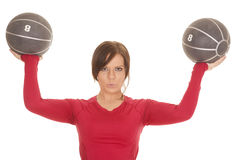 Woman red shirt two medicine balls serious royalty free stock image