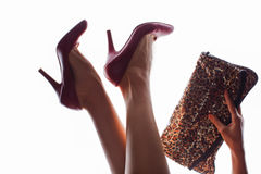 Woman in red shoes holding bag Stock Photos