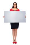 Woman in Red Showing Sign. Young woman in red showing empty Blank sign copyspace Isolated on White Stock Image