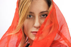 Woman in red silk headscarf Stock Image