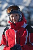 Woman in red on ski slope portrait Royalty Free Stock Photos