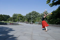 Woman in red skirt Stock Photography