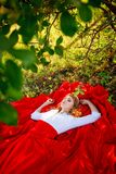 Woman in red skirt lying under the tree Stock Photography