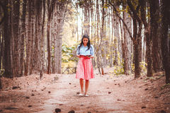 Woman in Red Skirt Surrounded by Trees during Day Time Stock Photo