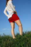Woman in red skirt Stock Images