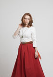 Woman in red skirt Royalty Free Stock Images