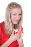 Woman in red with small present. Happy woman in red with small present Stock Photography