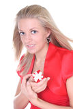 Woman in red with small present Royalty Free Stock Photos