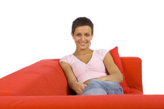Woman on the red sofa stock photo