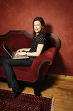 Woman on red sofa serie Royalty Free Stock Image