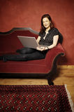 Woman on red sofa serie Royalty Free Stock Photography