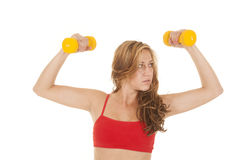 Woman red sports bra yellow weights flex Royalty Free Stock Photos