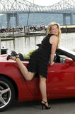 Woman red sports car. Sexy woman with red sports car by a yacht club on the  hudson river new york Royalty Free Stock Photo