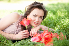Woman with red spring tulips in a garden Stock Images