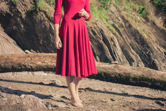 Woman in red standing on the beach Royalty Free Stock Photography