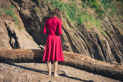 Woman in red standing on the beach Stock Photos
