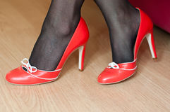Woman with red stilettos shoes Royalty Free Stock Photo