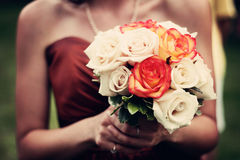 Woman in Red Strapless Dress Holding White and Red Bouquet Stock Image